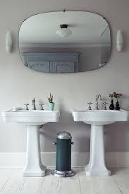 bathroom mirrors and sconce lighting interiordesignew com