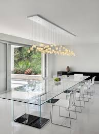 all glass dining room table contours of the tulip chandelier complement the form of the