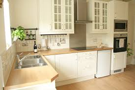 good looking ikea cream kitchen cabinets with brown countertop