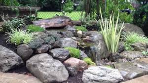 waterfalls water feature landscape ideas paver patio in brighton