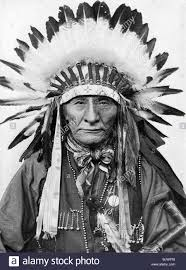 a native american chief wearing his headdress stock photo royalty
