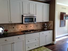 kitchen simple white shaker cabinet with classic backsplash 2