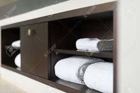 Bathroom Built In Furniture Wall With Built In Wooden Shelf Neat Stack Of White Soft Towels
