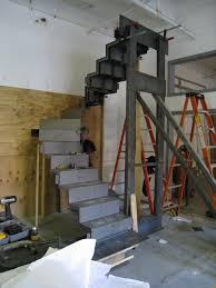 blackened folded steel plate stair caliper studio