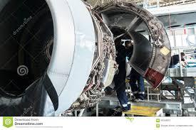 Turbine Engine Mechanic Disassembled Airplane For Repair And Modernization In Jet Hangar