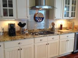 subway glass tile kitchen backsplash and beadboard style cabinet