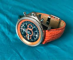 bentley turquoise any idea what the small button on the side of my breitling for