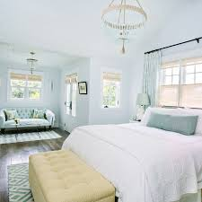 gray and blue headboard with green key bench cottage bedroom