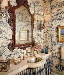 country french style interior powder room with ornate mirror and