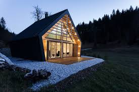 Small Two Bedroom House by The Dark Exterior Of This Wood House Encloses A Light Interior