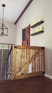 Child Gate Stairs by Diy Barn Door Baby Gate With Pet Door Instructions