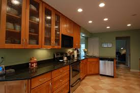Tiled Kitchen Ideas Cream Brown Tile Kitchen Floor Plus Brown Wooden Cabinet With