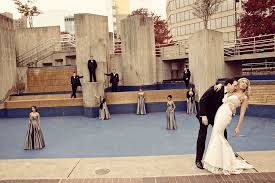 party venues in baltimore and groom pose with bridal party outside of wedding venue
