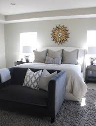 dark gray curved headboard with gray distressed nightstand