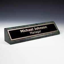 custom name plates on green marble desk wedge