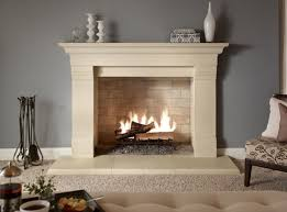 cream wooden wooden fireplace mantel with cream hearth connected