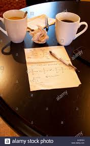molecular calculations on paper napkin on coffee shop table stock