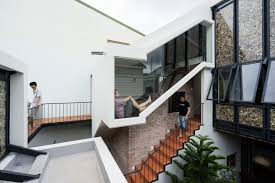 photos half roof house a marriage between old design and new a team of saigon based architects seeks to attain a harmonious balance between traditional vietnamese aesthetics and modern design elements in their latest