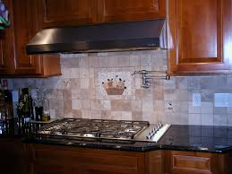 decorating brown ventahoods with merola tile backsplash and pot