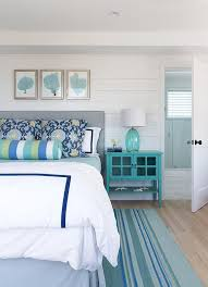 gray and blue bedroom with navy blue campaign nightstand