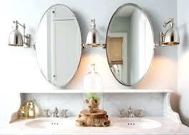 oval pivot bathroom mirror oval pivot mirror bathroom mounting brackets bath rejuvenation