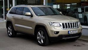 gold jeep grand cherokee 2014 gm chrysler recalling more than 400 000 vehicles michigan radio