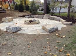 fire pit with seating large fire pit area with boulder tables and rock wall seating