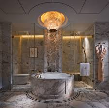 carlton suite in china the ritz carlton macau a marble room with a round marble tub a large chandelier a mosaic tile premier suite