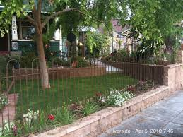 corner lot with wrought iron fencing decorative