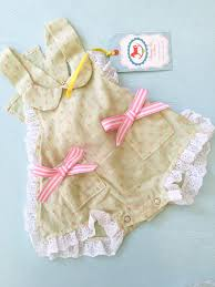 sunkissed sally sunsuit in sage green with bows runaway pony
