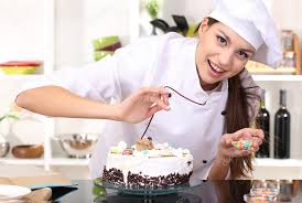 chef de cuisine femme chef de femme cuisine gâteau dans la cuisine photographie