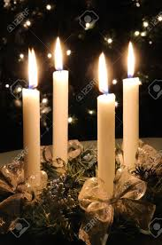 christmas advent wreath with burning candles lights on x mas