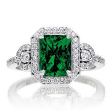 emerald rings uk 3 carat emerald cut emerald and white diamond halo engagement ring