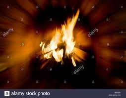 a log fire with bright flames burning in a fireplace a zoom