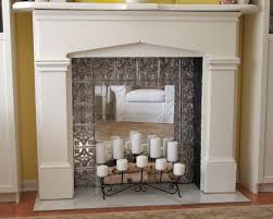 gorgeous faux fireplace made by snagging an old unused mantel and