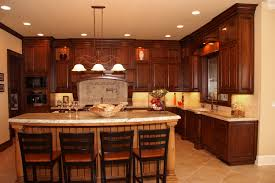 stained clear alder kitchen cabinets with a beautiful island