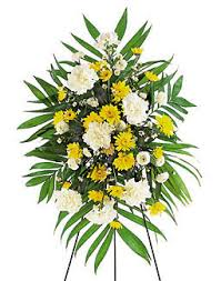 floral spray funeral flowers yellow and white floral spray