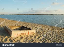 fire pit sand concrete fire pit on beach sunset stock photo 13659382 shutterstock