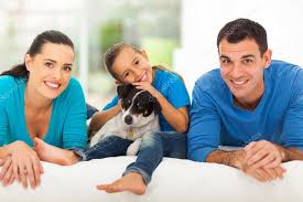 loving family lying on bed stock photo michaeljung 25520415