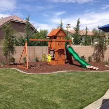 Creative Backyard Playground Ideas How To Landscape Under A Swing Set Helpfulhowtos