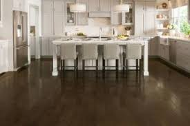 what color floor goes with brown cabinets floors vs light floors pros and cons the flooring
