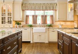 good looking u shape kitchen featuring cream color wooden kitchen