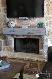 Make A Fireplace Mantel by How To Build And Hang A Mantel On A Stone Fireplace Shanty 2 Chic