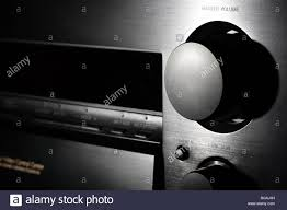 home theater amplifier black home theater amplifier volume knob close up shot in