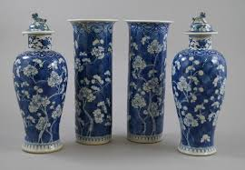 Chinese Vases Uk A Pair Of Chinese Blue And White Baluster Vases The Lids With
