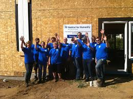 coast realty group realtors add some sweat equity to habitat