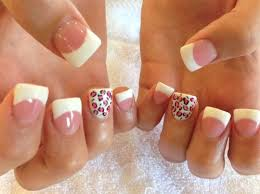 flared white tips with cheetah accent nail on we heart it