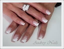 dessin sur ongle en gel french biseauté blanche liner blanc strass par audrey nails 91