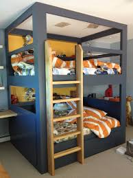 blue and white wooden bunk bed for teenagers using blue bed linen