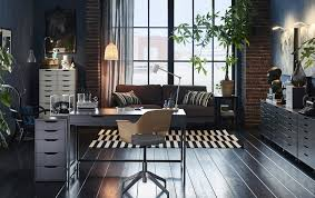 large home office a grey desk in the middle of a large home office combined with a